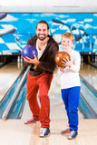 Father and son in bowling center Stock Images