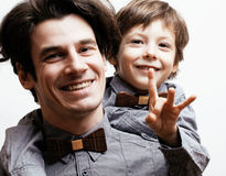 Father with son in bowties Royalty Free Stock Images