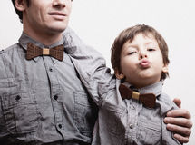 Father with son in bowties on white background, Royalty Free Stock Photo