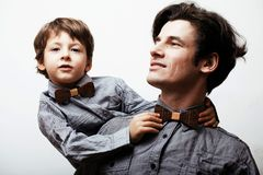 Father with son in bowties on white background, casual look Stock Images