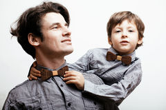 Father with son in bowties on white background, Stock Photos