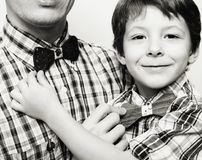 Father with son in bowties on white background, casual look family Stock Image