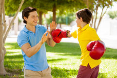 Father and son boxing outdoors Stock Photos
