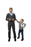 Father and son. Boy with soccer ball in hand calls adult men to play football isolated on white background - Father and son - sport, leisure and relations in Stock Photography