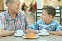 Father with son at breakfast Stock Image