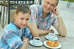 Father with son at breakfast Stock Photography