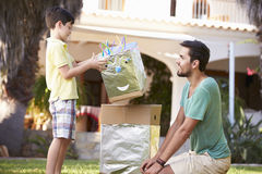 Father And Son Building Model Robot In Garden Stock Photo