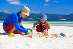 Father and son building sandcastle on the beach Stock Photography