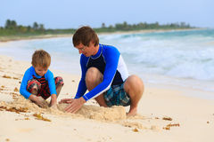 Father and son building sandcastle on the beach Royalty Free Stock Photography