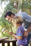 Father And Son Building Tree House Together Royalty Free Stock Images