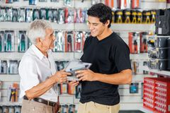 Father And Son Buying Drill In Store Royalty Free Stock Images