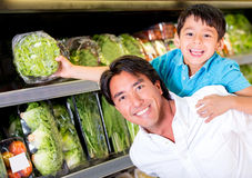 Father and son buying groceries Royalty Free Stock Photo