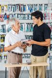 Father And Son Buying Tools In Store Stock Photography