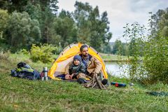 Father and son in camping at lake. Father and son sitting in camping with tent at lake Royalty Free Stock Photography