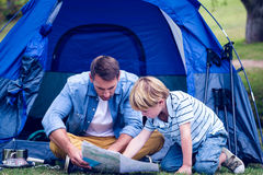 Father and son camping in the park. On a sunny day Royalty Free Stock Photography