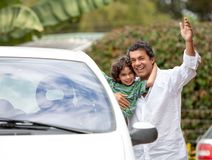 Father and son with a car Stock Images