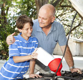 Father and Son Car Maintenance Stock Photography