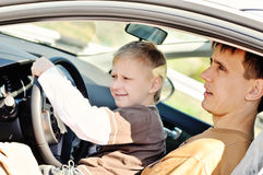 Father and son  in a car Stock Images