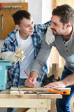 Father and son in carpentry workshop Stock Photos