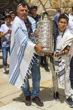A Father and Son carry a Sefer Torah Case at his Bar Mitzvah in stock photos
