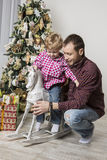 Father and son celebrating Christmas Stock Photos
