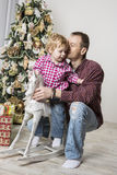 Father and son celebrating Christmas Royalty Free Stock Photo