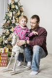 Father and son celebrating Christmas Royalty Free Stock Photos