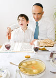 Father and son celebrating passover. Reading the Hagada Stock Photography