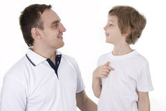Father and son cheerfully talk. On a white background Royalty Free Stock Image