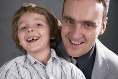 Father and son cheerfully talk. Stock Image