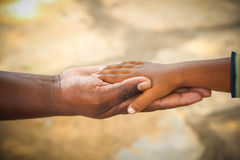 Father and Son. Child holding father's hand. Trust, togethterness and support concept Royalty Free Stock Photos