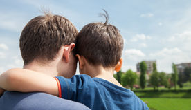 Father and son on a city background Stock Photography