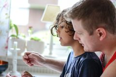 Bb gun cleaning. Father and son clean a bb gun together Stock Photo