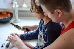 Bb gun cleaning. Father and son clean a bb gun together Stock Images