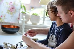 Bb gun cleaning. Father and son clean a bb gun together Royalty Free Stock Image