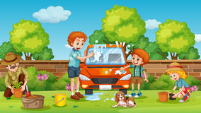 Father and son cleaning car in the yard Royalty Free Stock Photo