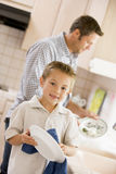Father And Son Cleaning Dishes Royalty Free Stock Image