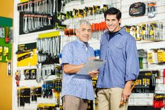 Father And Son With Clipboard In Hardware Store Royalty Free Stock Photography