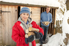 Father and Son Collecting Logs From Wooden Store Stock Images