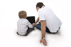 Father and son with the computer. Stock Photography