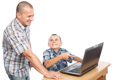 Father and son at the computer Royalty Free Stock Image