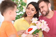 Father and son congratulating mom. Happy Mother`s Day. Father and son congratulating mom at home. Happy Mother`s Day royalty free stock photos