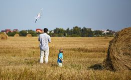 Father and son controls RC plane in the sky Royalty Free Stock Images