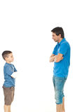 Father and son conversation. Father and son standing face to face and having conversation isolated on white background Royalty Free Stock Photo