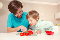 Father and son cook pepper Royalty Free Stock Photography