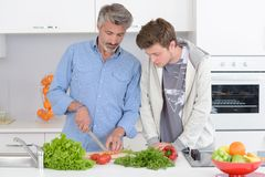 Father and son cooking. Young stock photo