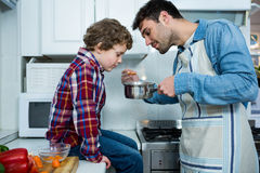 Father and son cooking food together Stock Images