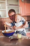 Father and son cooking Royalty Free Stock Images