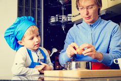 Father and son cooking in kitchen Stock Photos