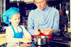 Father and son cooking in kitchen Stock Image